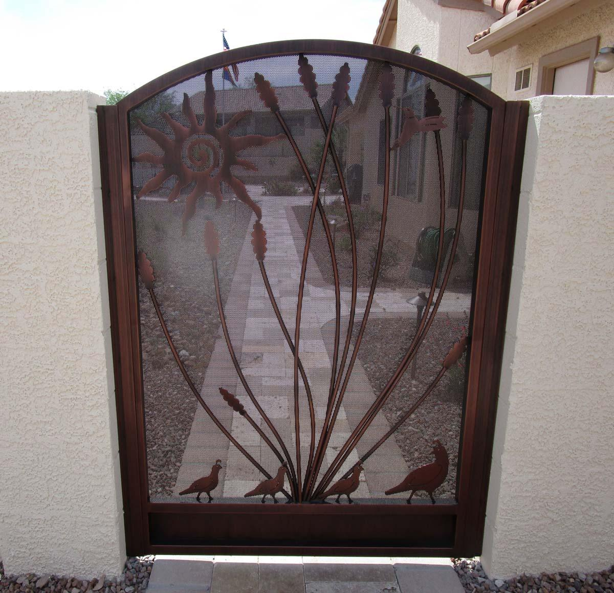 Arched courtyard wrought iron gate with bronze finish, ocotillo and sun motif IMG 0488