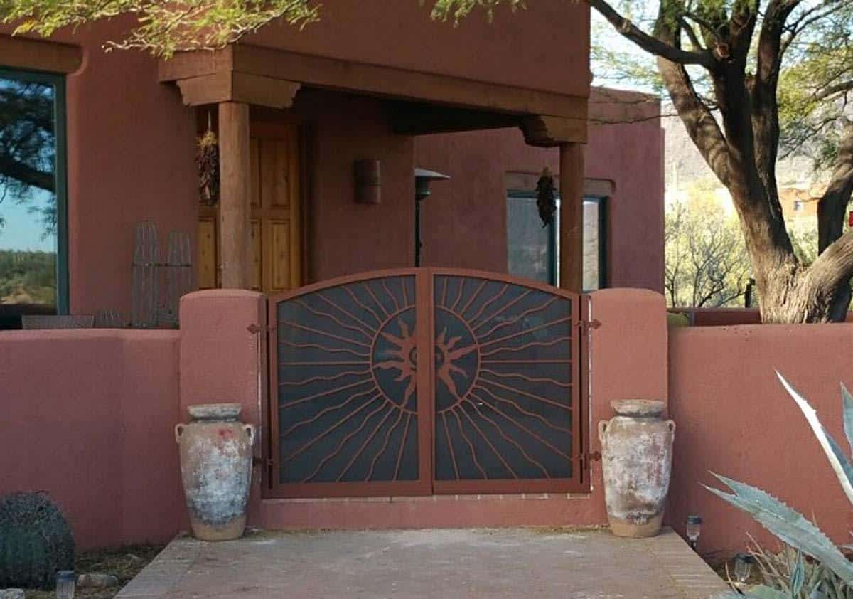 Double wrought iron gate with double sun rays in alternate wavy pattern and perforated metal backing plate 080924 - Made in Tucson