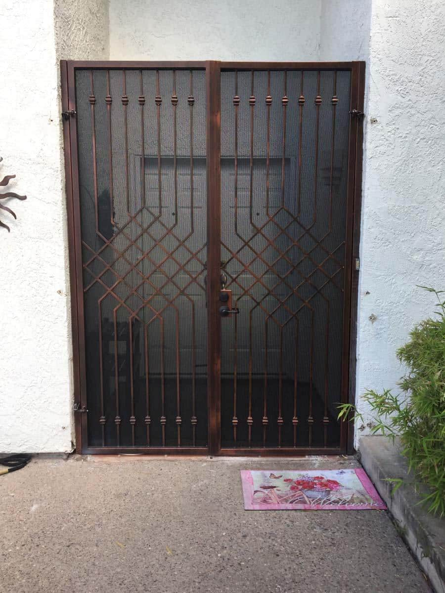 Double wrought iron gate with diamond geometric motif, knuckles and metal backing plate 12502 - Made in Tucson
