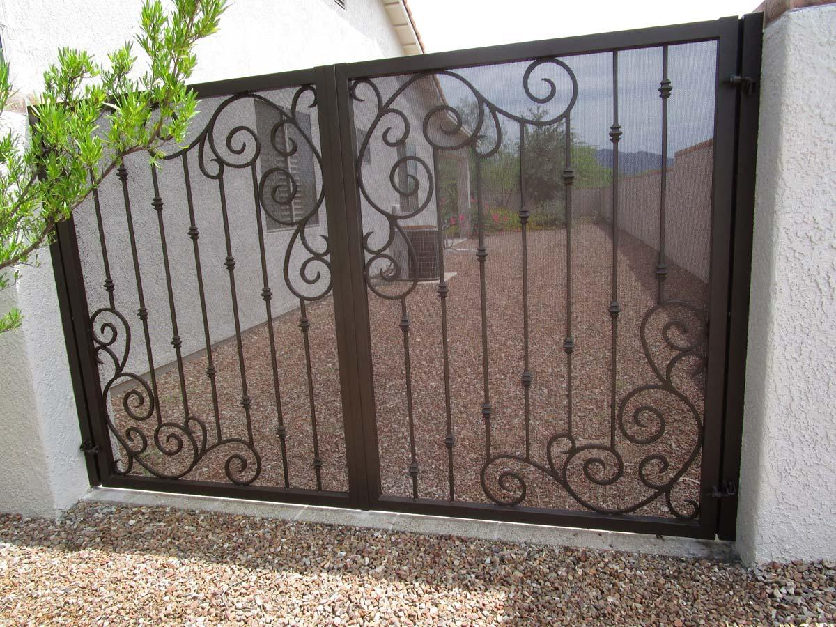 Double wrought iron gate with symmetrical scroll work in the corners and knuckles and the bars 865 IG