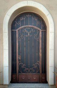 High security door arched top HDR - with knuckles, swirls and flower motifs on bottom panels - Made in Tucson