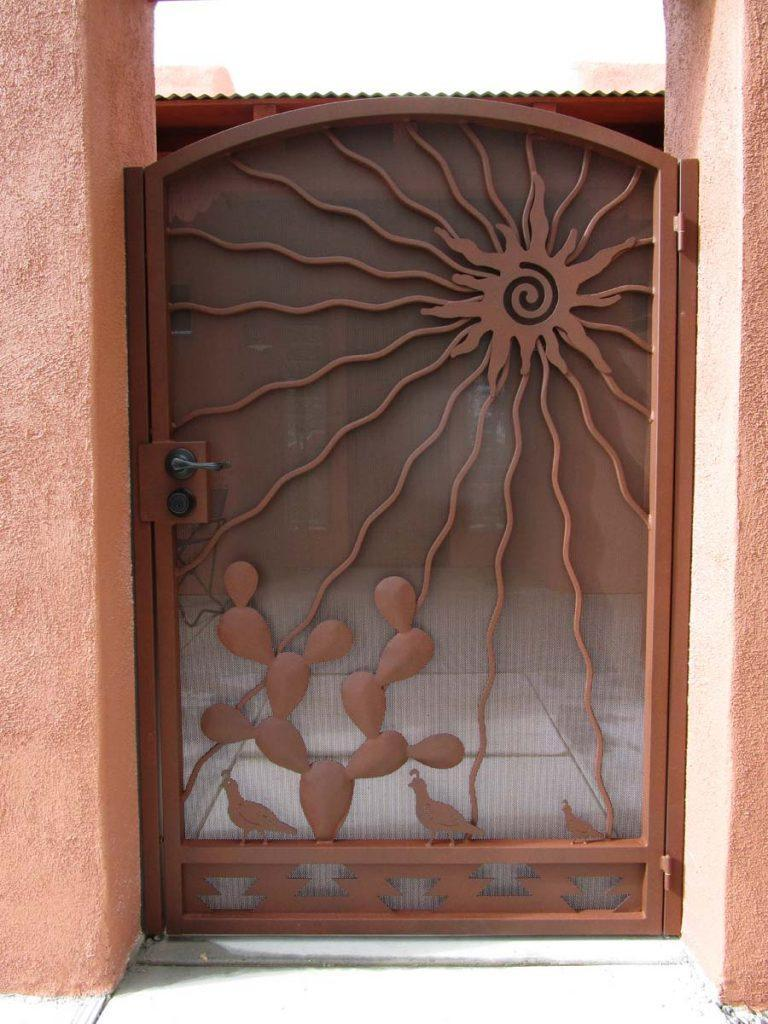 Southwestern Style iron gate with sun prickly pear cactus and quail