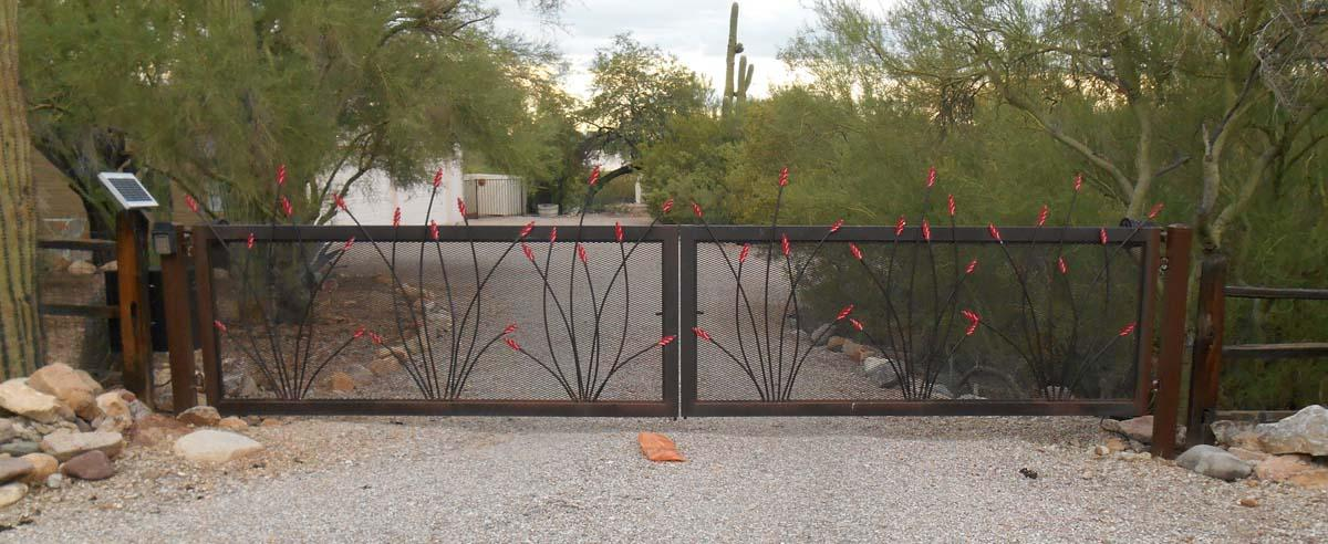 Large solar-powered automatic driveway gate with ocotillo cutouts and expanded steel backing DSCN0184