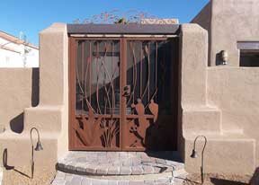Ornamental Iron Gates (double wrought iron gate) with southwestern cutouts