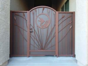 Security door with hummingbird and ocotillo motifs - 3 panels and arched door - Made in Tucson