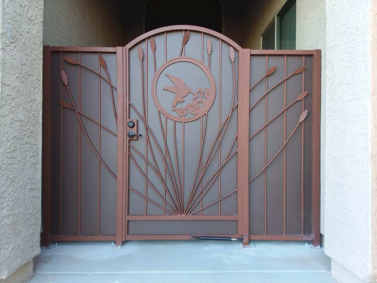 Security door with side panels and southwestern decoration
