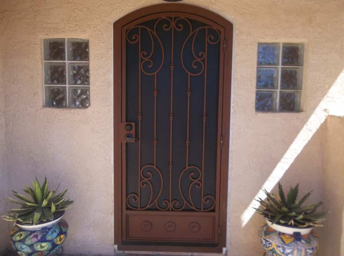 Security iron door with swirls and knuckles 100 0725 - Made in Tucson