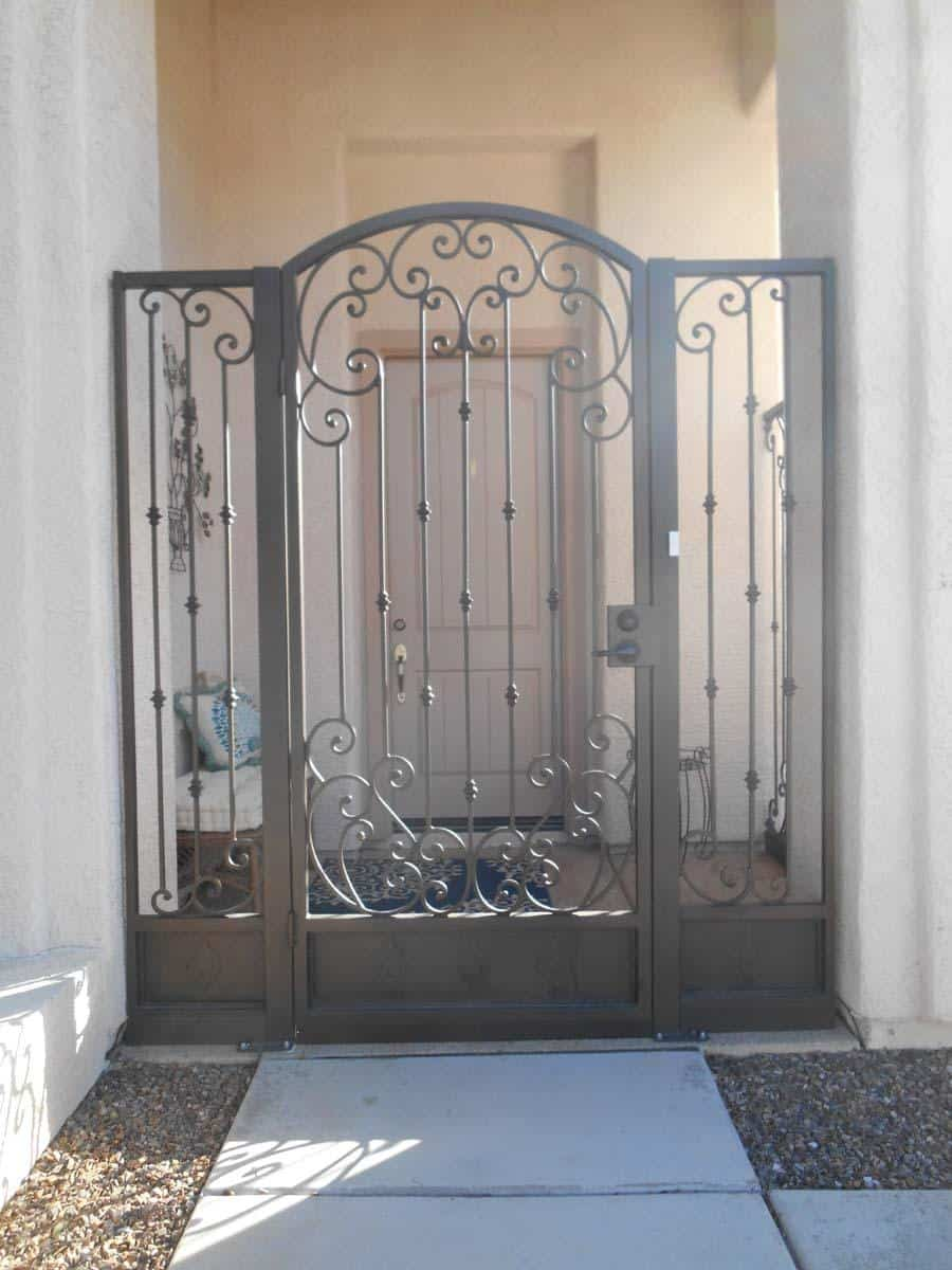 Tall decorative wrought iron gate with side panels with scroll work and knuckles on pickets 0546 Made in Tucson