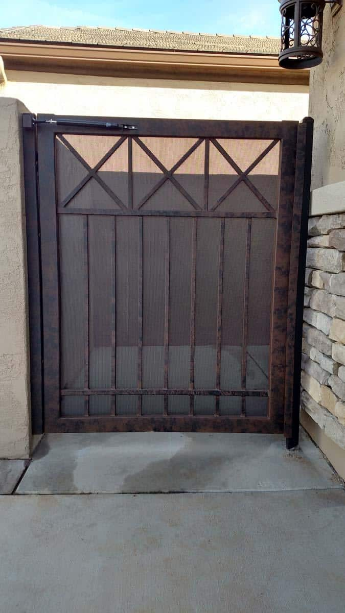 Wrought iron courtyard gate with a simple geometric pattern 093057452 HDR