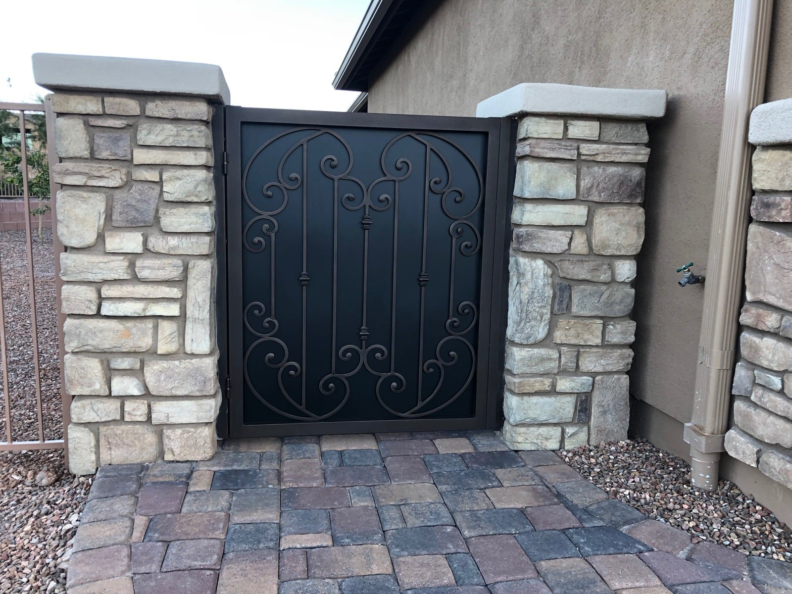 Wrought iron garden gate with scroll work and metal backing 0826