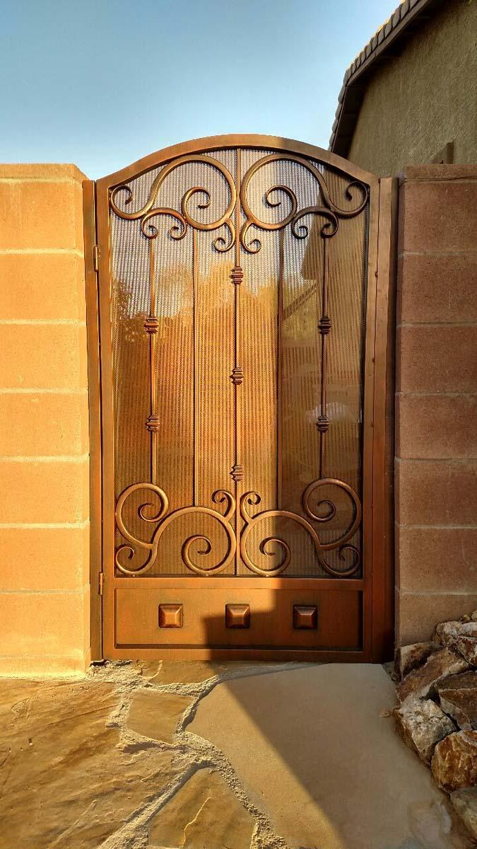 Wrought iron garden gate with scroll work and clavos on kick plate 20180605 055057093 HDR