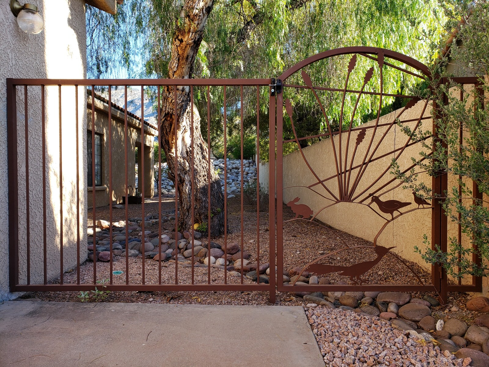 Wrought iron gate and fence with southwestern motifs, like roadrunner, rabbit, quail, sun rays and ocotillo 073941