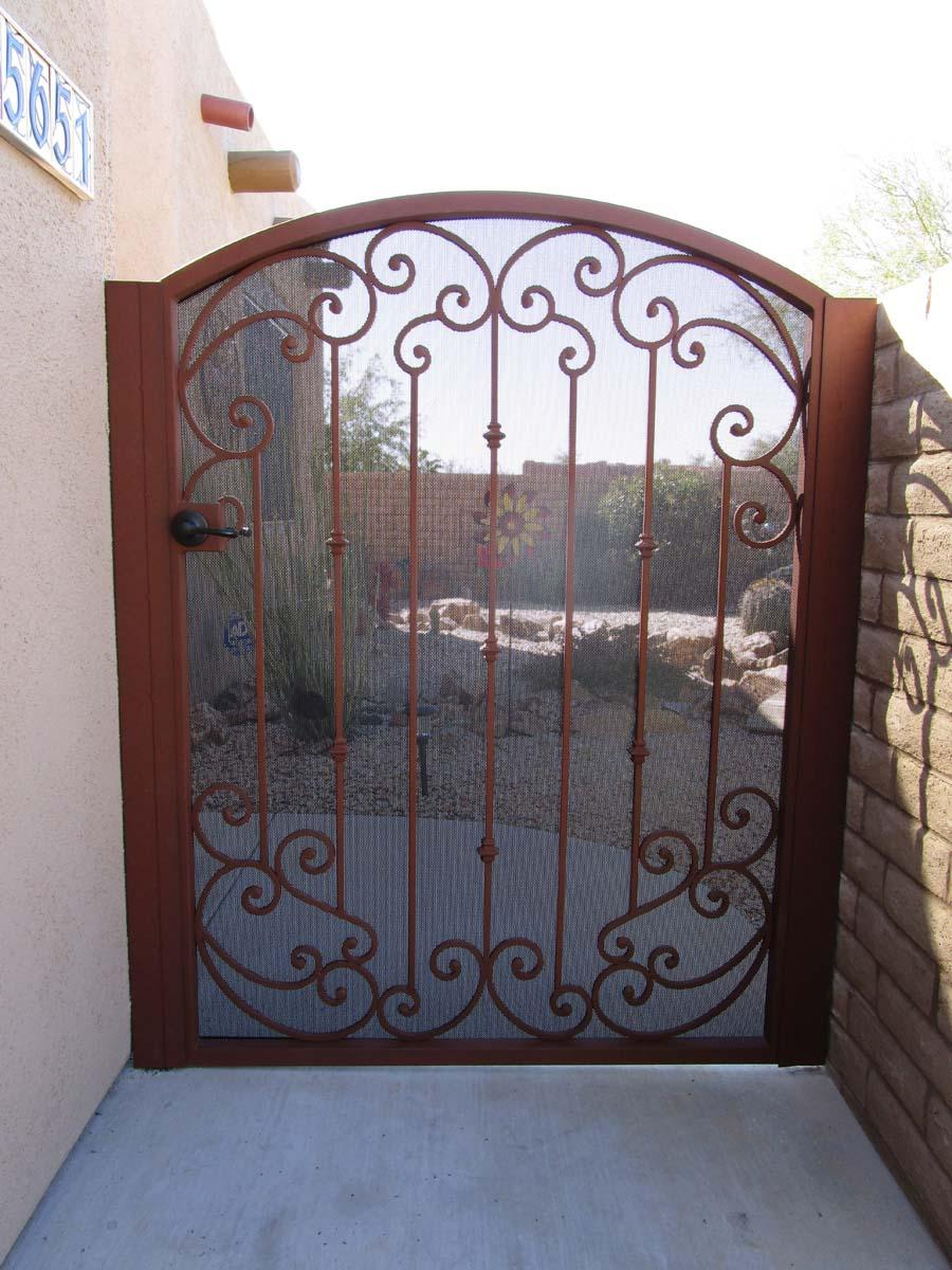Wrought iron gate with top and bottom scroll work and knuckles IMG 0448 - Made in Tucson