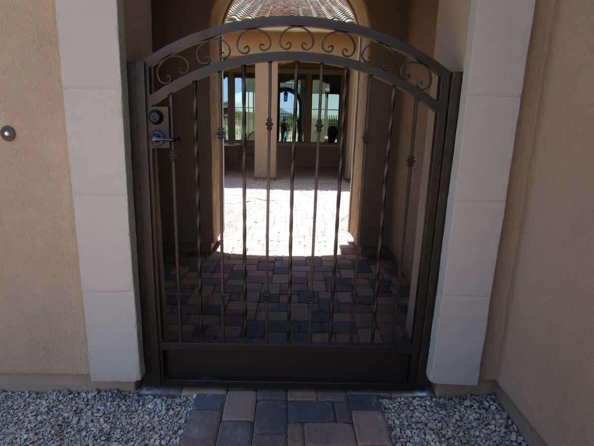 Wrought iron security gate with alternate twisted pattern enclosing a courtyard IMG 0544