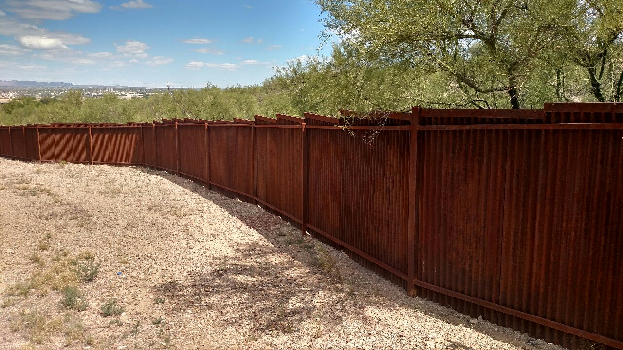 Corrugated steel fence - graded - rust patina - Affordable Fence and Gates